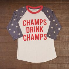 Drink champagne while sporting a comfortable all american tee! Champs Drink Champs American Baseball Tee – Bobbie Knows