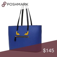 Fabulous blue navy monster handbag This beautiful handbag I worn only twice is it really good condition. It's blue navy from outside with two yellow monster eyes on the front of the bag. is fantastic handbag and you can wear for any occasion Fendi Bags Totes