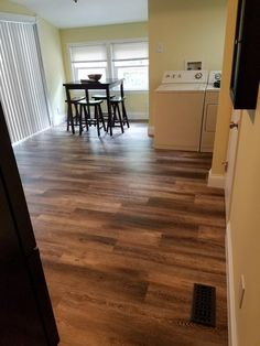 """Beachcomber Oak waterproof EVP in a customer home! """"Recently did a small kitchen reno to give it an updated look. Vinyl was easy to install and turned out great. Changed the whole look of the room and is very durable."""""""