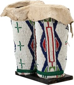 A PAIR OF SIOUX WOMAN'S BEADED HIDE LEGGINGS . c. 1900... (Total: | Lot #50031 | Heritage Auctions