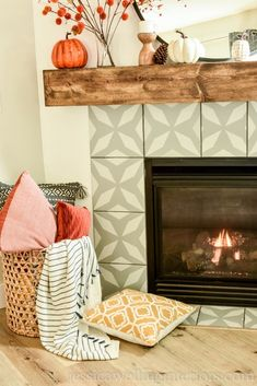 Warm up your fireplace this Autumn with these simple and modern boho Fall mantle decor ideas! Bring in an orange and mustard yellow color pallette for Fall with pumpkins. stems, and throw pillows.