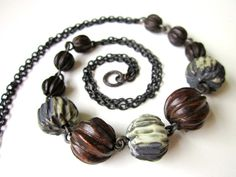Never Tell Me the Odds - dark rustic fluted pale mint green gray porcelain beads, carved graduated wood beads, black copper chain necklace by LoveRoot