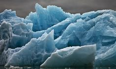 """For many of us, the climate crisis is a giant social, economic and environmental specter; for photographer Camille Seaman, it's personal. A Shinnecock Indian, Seaman sees """"images of icebergs as portraits of individuals,"""" akin to family photos — only these faces are dissolving."""