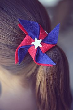 red, white and blue. one of my most favorite color combos. It's always fun to be festive on the 4th of July. So we made some pinwheel hairclips for the girls to wear that day. You'll need: • red, white and blue felt sheets (these even came with glitter on them) • small wood stars …