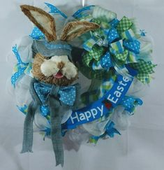 Happy Easter is this beautiful Blue Rabbit with Lime Green/White/ Blue Ribbon. Sign was Hand painted and the Two Carrots was hand painted with the Happy Easter in Vinyl.