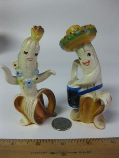 """""""Enesco Banana People Salt & Pepper Shakers."""" These banana musician/salt-'n-pepper shakers meet my kitsch criteria. They're (1) technically well done, and (2) make me feel something. In this case, they have a goofy, silly, festive quality -- what my English cousin would call """"jolly."""" And for me, they function as pretty effective anti-depressants (no side effects)."""