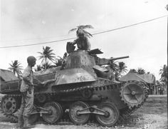 "supermarketsecurity: "" American troops inspect a captured Type 95 Ha-Go, Guam """