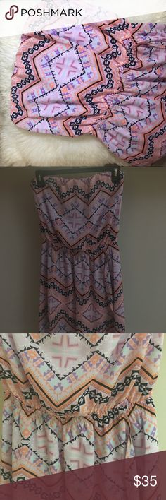 NWT Express strapless tribal print dress! This dress is brand new, it has a ruched waist and falls beautifully in the front, it is a little bit of a high low style and has a slip underneath! Dresses Midi