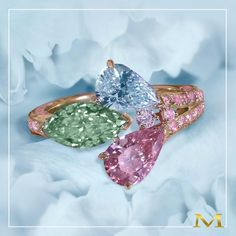 Moussaieff. An extraordinary multicoloured diamond ring featuring natural fancies; blue, intense pink and yellow-green diamonds on a pink round diamond set rose-gold band.
