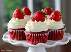 Red velvet cupcake with.butter cream.and strawberries