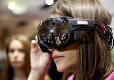 A television reporter wears a pair of Liquid Image OPS (Operation Powder Search) winter sports goggles during the 2014 Consumer Electronics Show. The device includes a camera to record what the user sees while skiing, or participating in other winter sports.