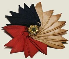 Tri-Color Cockade: not only an accessory or piece of art, but a symbol of the French Revolution. With all the fighting and brutality that took place, the symbol had to be worn and stitched to garments. If the symbol was not worn, there was a chance you could be killed.