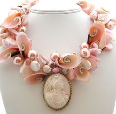 Love this necklace..an updated version of the classic Cameo, using soft pink toned shells and pearls.