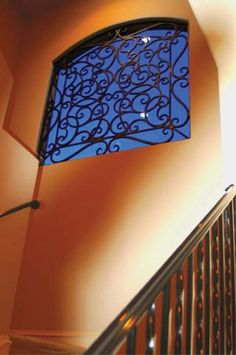 Choose Faux Iron Art to add that something special to windows that allow natural light into your home.