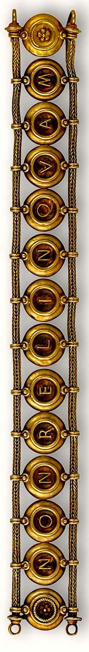 """Important, rare, 18k gold bracelet, by the famed Italian jeweler Castellani, ca.1890 in the Renaissance Revival Style. The red micro mosaic discs slide on woven borders; bracelet is reversible, spelling out NON RELINQVAM on one side, NON RELINQVES, on the other. translates from the Latin to """"I will never give up on you/ you will never give up on me"""" There are rope-twist and floral details on terminals. Only three were made. One was bought by Jackie Kennedy Onassis at auction."""