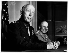 Lieutenant General James Doolittle and General George Patton mug for the camera at a Los Angeles press conference, ca. 1945.