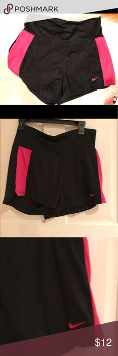 Brand new Nike dry fit shorts Brand new. Nike dry fit. Black and pink shorts. No tags. Has a little mesh pocket on the inside lip of the shorts. Size M. Nike Shorts
