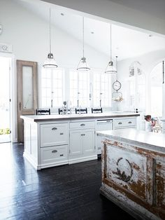great dark floors.   Love the old and new cabinets in this kitchen.