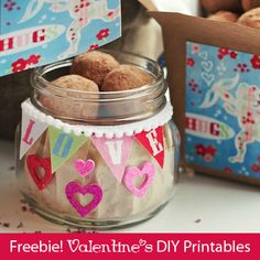 Free DIY Valentine's Day printables by Marla Meridith. Cherub design with flowers and hearts. Chocolate truffles in mason jars, budget holiday gifts