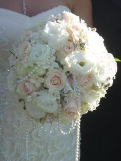 Beautiful! I love the draped pearls in the bridal bouquet!