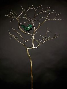 Simplistic, natural, metal sculpture. Good for outdoorsy, low cost sculpture