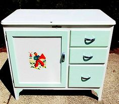 mine is similar configuration, white enameled top with red design.  Will repurpose for new sewing room