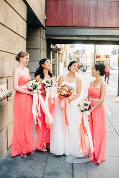 We love these coral bridesmaid dresses and flowing ribbons | Photography: Kelsey Stewart - www.kenkienow.com/category/kelsey/  Read More: http://www.stylemepretty.com/california-weddings/2015/01/14/whimsical-san-francisco-summer-wedding/