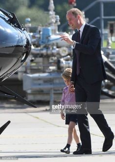 Britain's Prince William Duke of Cambridge and his son Prince George visit an Airbus helicopter on the tarmac of the Airbus compound in Hamburg...