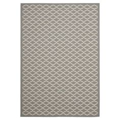 Anchor your patio furniture or add a pop of pattern to your foyer with this versatile rug, showcasing a chic trellis motif.  Product...