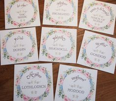 Elvish Wedding Seating Plan and Table Name Cards for a Lord of the Rings themed Wedding in Pink and Blue.
