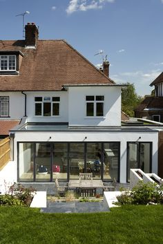 https://flic.kr/p/9XLA3o | www.crawfordpartnership.co.uk | CONTEMPORARY HOUSE RENOVATION AND EXTENSION CROUCH END NORTH LONDON  New aluminium sliding folding doors span the full width of the garden extension and a structural glass fixed rooflight also spanning across the extension both combine to maximise daylight within the newly created kitchen and dining area connecting the space seamlessly to the garden when doors are opened fully.  London Architects and Interior Designers…