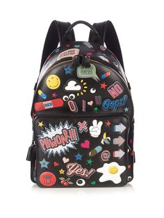 Anya Hindmarch's black lightly grained-leather backpack is covered with an eclectic mix of colourful embossed stickers, inspired by the designer's penchant for personalisation.