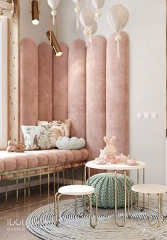 Play area in the nursery for the little Princess. Pink soft panels and a stylish. Play area in the nursery for the little Princess. Pink soft panels and a stylish sofa by the window