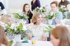 a floral workshop hosted by mint and lovely studios teaching students how to create their own organic and sweeping floral arrangements