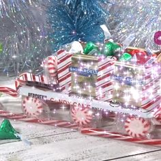 Candy Sleigh How to build Santa's sleigh out of Christmas candy – so cute! Candy Sleigh How to build Santa's sleigh out of Christmas candy – so cute! Christmas Candy Crafts, Christmas Goodies, Christmas Projects, Holiday Crafts, Christmas Holidays, Christmas Decorations, Christmas Ornaments, Christmas Treats, Diy Christmas Gifts Videos