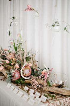 Antlers and king protea | Kristyn Hogan Photography | see more on: http://burnettsboards.com/2014/09/rustic-refined-driftwood-wedding-inspiration/