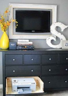 frame tv on wall like artwork and add hinges to a drawer to hide electronics! WE CAN DO THIS TO OUR DRESSER since it has smaller longer drawer up top : good for NOTHING.. Now its useable::::3333>>>>