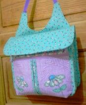 Sandy Kiester of Kansas received her Gadabout pattern as a gift from a friend and she proceeded to make her bag out of fabric in her stash. Sandy said that the applique design is from Sweet Pea Embroidery Designs.