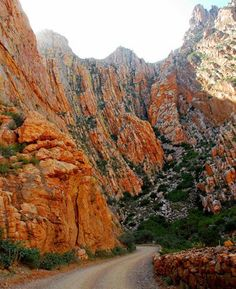 The Swartberg Pass on the R328 run through Swartberg mountain range (black mountain in English) which runs roughly east-west along the northern edge of the semi-arid area called the Little Karoo in the Western Cape province of South Africa