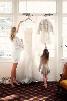 Great idea..a picture with the wedding dress and flower girl dress. So precious!