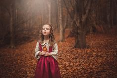 Magical Autumn or Fall colours.  This is how childhood feels. Warm, a touch of the otherworld, sometimes serene, the colours are brighter and the world is new. I really worked on the colour editing of this image to enhance the autumn colours. Children photography Melbourne