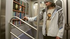 Underground Library (New York) - This virtual library shelf would let New York subway passengers read the first 10 pages of a book on their smartphones before directing them to the nearest library to pick up a hard copy / 地下鉄図書館(ニューヨーク) - 地下鉄の車両広告枠に設置された本棚の写真にスマホをかざして通信すると本の中身が10ページ読める→読み終わるとこの本が置いてある図書館が表示される。