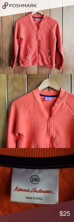"""NEW Hanna Andersson quilted jacket A cute zip-up coral/orange colored quilted jacket by Hanna Andersson. Cute elbow pad details and ribbing around edges. Two front pockets. A couple tiny holes in front, pictured. Overall good condition! Offers welcome!   Shoulder to shoulder 15"""" Armpit to armpit 18.5"""" Shoulder to hem 20.5"""" Shoulder to wrist 17.5"""" Hanna Andersson Jackets & Coats"""
