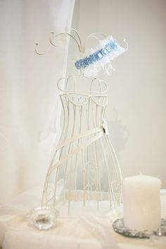 dressing table decor on wedding day. had a mini mannequin with my garter hanging off