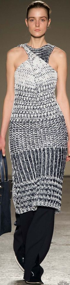 Gabriele Colangelo F-15 RTW: knitted sleeveless dress with a bias-cut drape that twisted around the torso, pants were sliced vertically at the front hem.