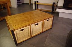 A coffe table made from pallet and IKEA boxes