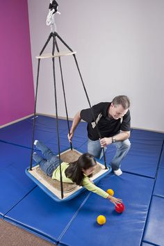 Advantage Line Platform Swing: Reaching and grasping objects from a swing can provide proprioceptive input.