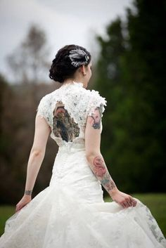 Tattoed bride. Beautiful!!! I want my back shown in my wedding