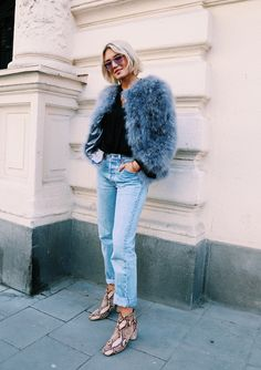 Chubby fur with jeans and snakeskin booties.