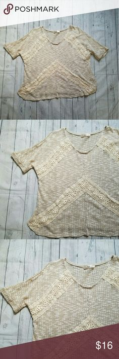 Lightweight lace detail sweater Half sleeve, boxy, open knit sweater, with crochet lace chevron. Beige and white knit with cream lace. 24 inches across the bust. 24 inches long. 52% cotton, 48% polyester. Excellent condtion. trace Sweaters